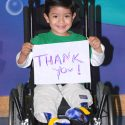 Boy in Wheelchair with Thank You sign